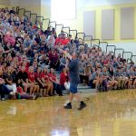 Superintendent Golden speaks to staff in Timber Ridge gym